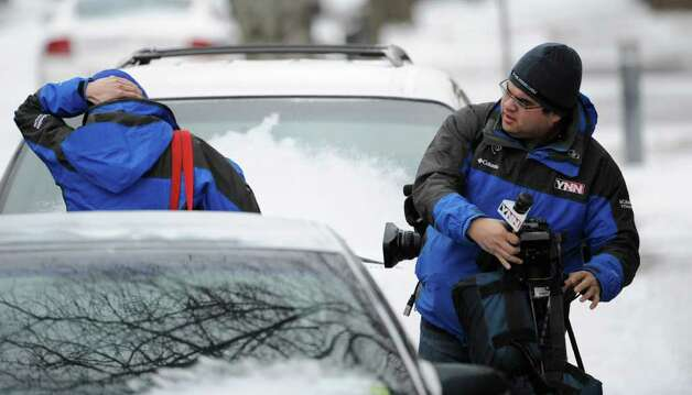 YNN reporter Erin Vannella and videographer Ken Deyo at the scene of a hostage situation Thursday morning on Westerlo Street in Albany.  Vannella later spoke to the man inside the home by phone. (Skip Dickstein / Times Union) Photo: SKIP DICKSTEIN