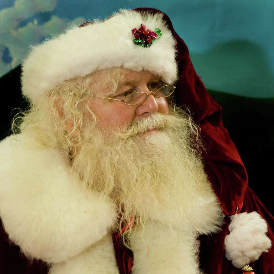 """Alton Horn, Jr., a Santa's helper for 30 years, poses for a portrait from his seat at Willowbrook Mall Saturday, Dec. 19, 2009, in Houston. """"I advise any many that can (play a Santa's helper) to do it,""""  said Horn, who was selected to be his first grade class Santa in 1949. """"There is nothing like what you see in a child's eyes in the magic of Santa."""" ( Brett Coomer / Chronicle ) Photo: Brett Coomer, Staff / Houston Chronicle"""