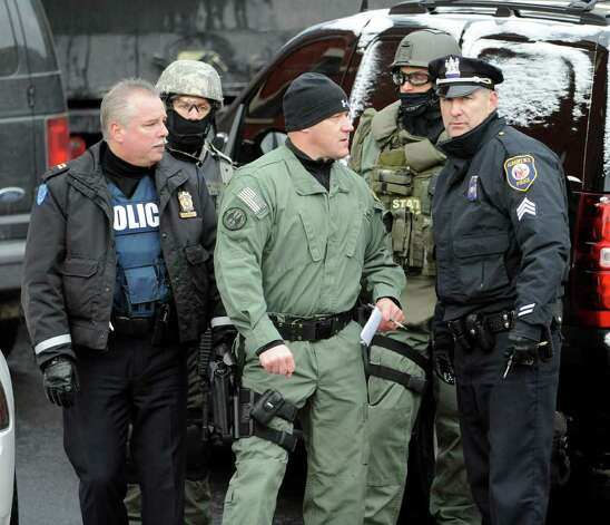Members of the Troy Police Department's Emergency Response Team, State Police Special Operations team and the Albany Police gather at the scene of a hostage situation on Westerlo Street in Albany on December 23, 2010.    (Skip Dickstein / Times Union) Photo: SKIP DICKSTEIN