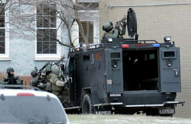 Members of the State Police special operations team bring their armored vehicle to the scene of a hostage standoff Thursday on Albany's Westerlo Street in Albany. (Skip Dickstein / Times Union) Photo: SKIP DICKSTEIN