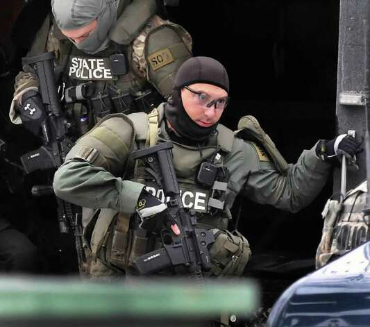 State troopers armed with assault rifles set up at the scene of a hostage situation Thursday on Green Street in Albany.  (John Carl D'Annibale / Times Union) Photo: John Carl D'Annibale
