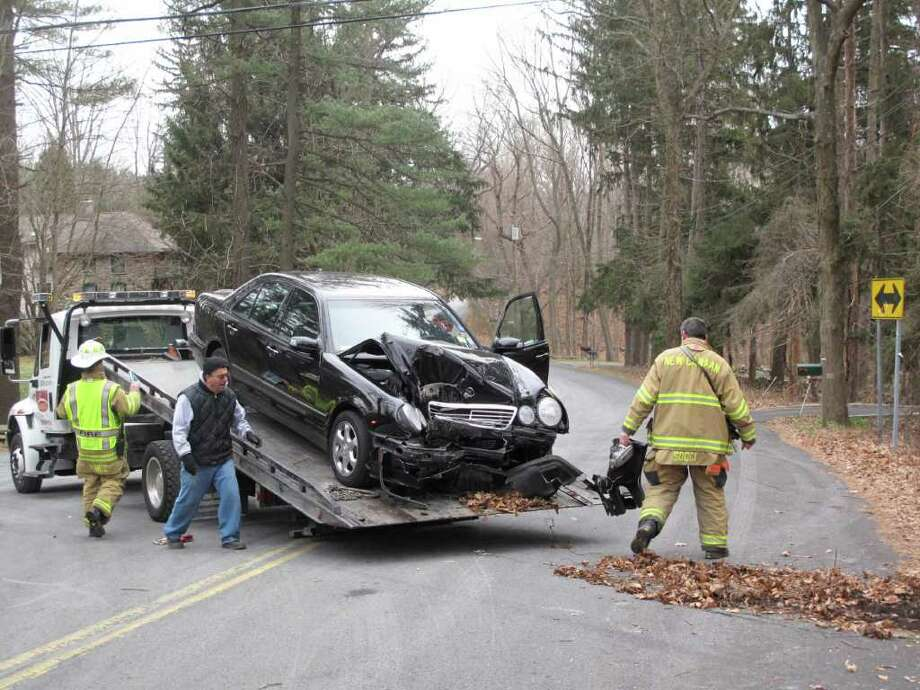 The vehicle suffered serious damage in the front Photo: Contributed Photo / New Canaan News