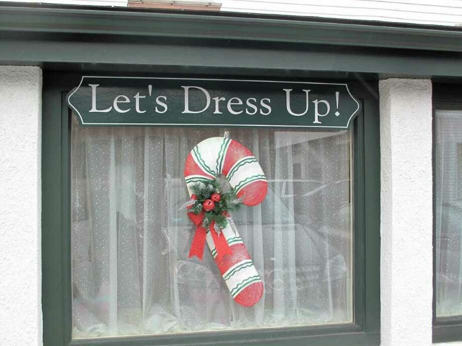 New Canaan business Let's Dress Up boasts festive candy canes on their windows Photo: Contributed Photo / New Canaan News