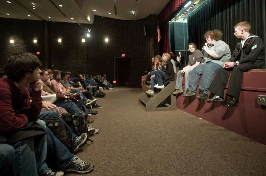Bethel High School students listen in the high school auditorium, to 2009 and 2010 Bethel High School graduates talk about life in college. Thursday, Dec. 23, 2010 Photo: Scott Mullin / The News-Times Freelance