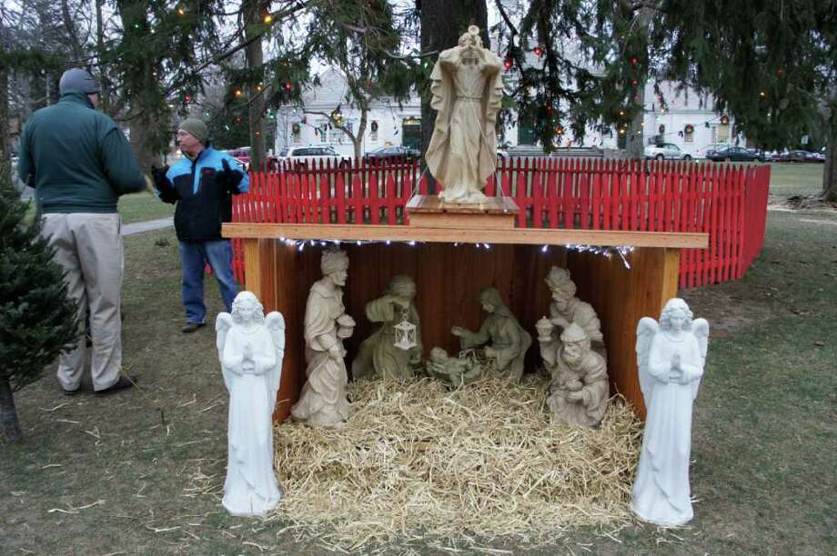 Knights of Columbus members, Dave Reynolds, left, and Ken Elwood, right, supervise the Knights' Christmas creche on the green next to Old Town Hall. The creche has been a long-time Fairfield Christmas tradition started by the late Nello Ceccarelli. Photo: Paul Schott / Fairfield Citizen