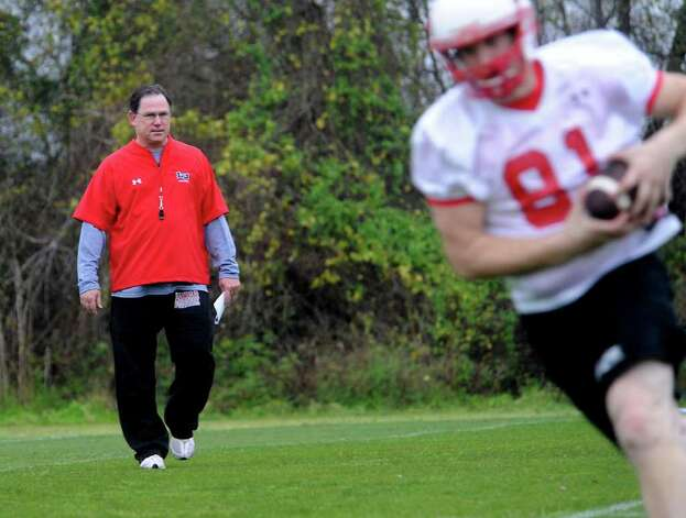Offensive Coordinator, Todd Whitten watches as Jeremy Granger runs the ball during the first day of spring football practice at Lamar University in Beaumont, Tuesday.  Tammy McKinley/ The Enterprise Photo: TAMMY MCKINLEY / Beaumont