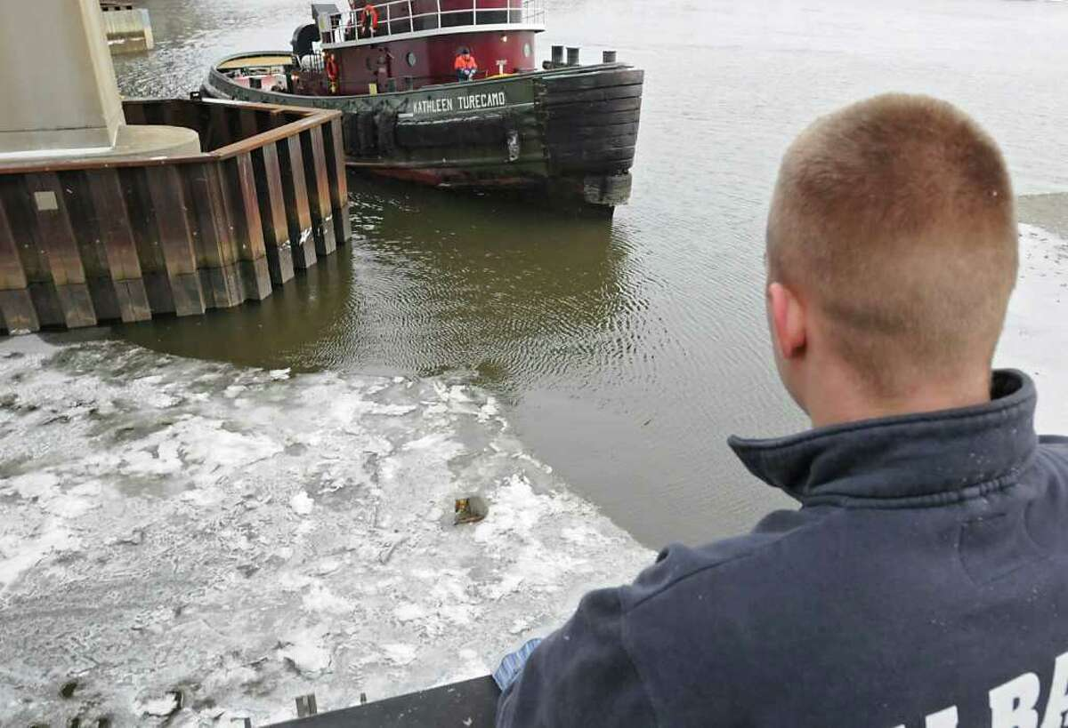 Crew on the tugboat Kathleen Turecamo show up to try to rescue a gray fox stranded on some thin ice on the Hudson River under the Dunn Memorial Bridge in Albany, NY, on December 23, 2010. (Lori Van Buren / Times Union)