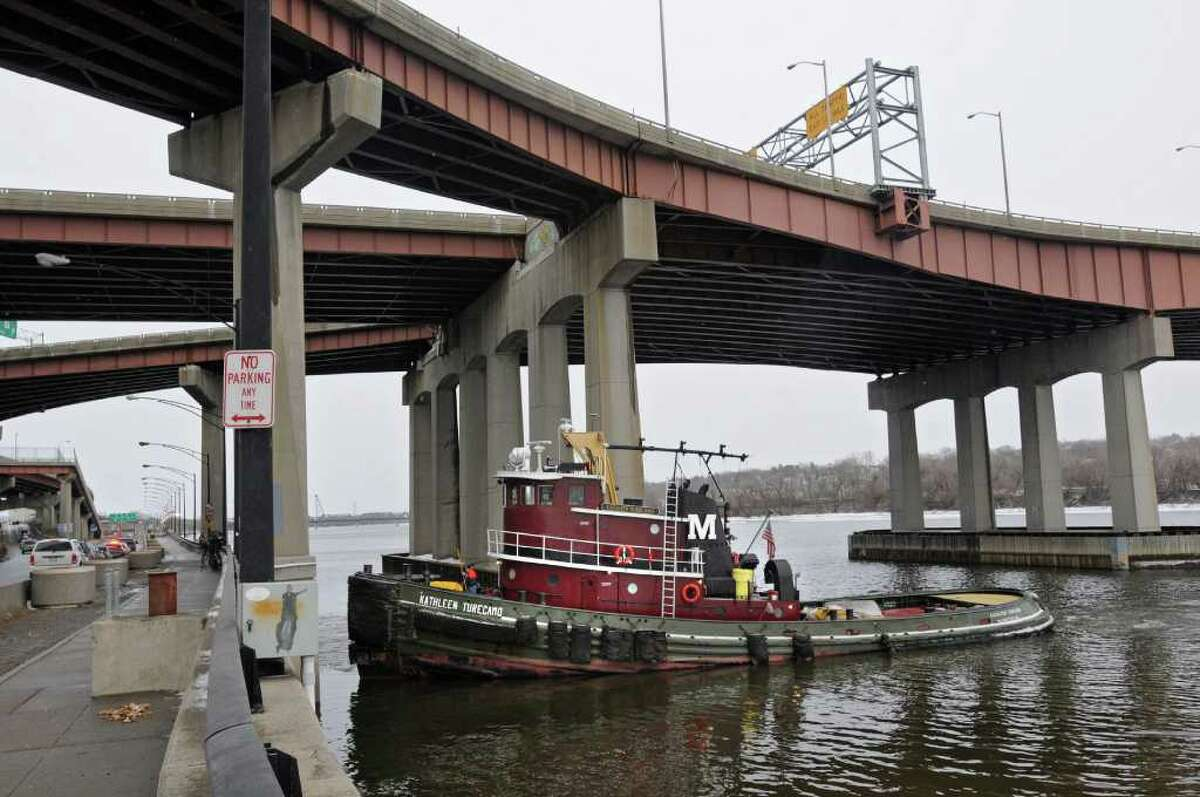 The scene where a gray fox was stranded on some thin ice on the Hudson River waiting to be rescued under the Dunn Memorial Bridge in Albany, NY on December 23, 2010. An air boat finally came and rescued the fox after the crew on this tugboat tried but failed. (Lori Van Buren / Times Union)