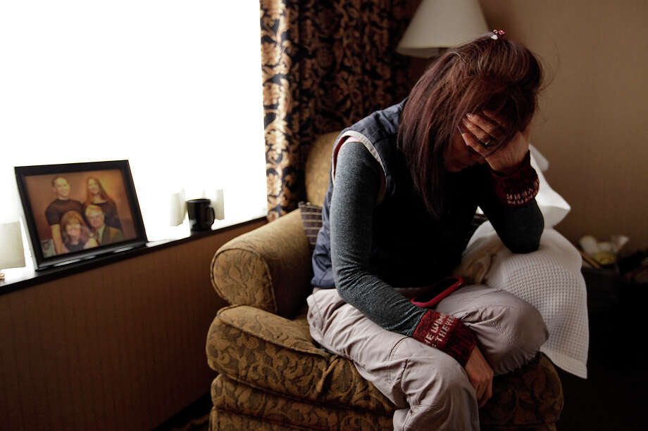 Won Sun Cullum, 55, mourns the death of her son Tavan Cullum. Cullum, 31, was shot and killed by police on Dec. 2. Cullum led the police on a low speed chase west on IH-10 West that ended with his death near Boerne. The family is staying at the hotel because Cullum set fire to the home before the chase. Photo: Jerry Lara/glara@express-news.net