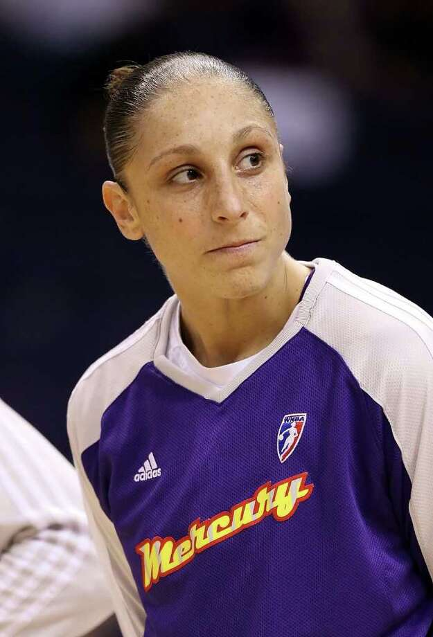 PHOENIX - AUGUST 26:  Diana Taurasi #3 of the Phoenix Mercury warms up before Game One of the Western Conference Semifinals against the San Antonio Silver Stars during the 2010 WNBA Playoffs at US Airways Center on August 26, 2010 in Phoenix, Arizona. The Mercury defeated the Silver Stars 106-93.  NOTE TO USER: User expressly acknowledges and agrees that, by downloading and or using this photograph, User is consenting to the terms and conditions of the Getty Images License Agreement.  (Photo by Christian Petersen/Getty Images) *** Local Caption *** Diana Taurasi Photo: Christian Petersen, Getty Images / 2010 Getty Images