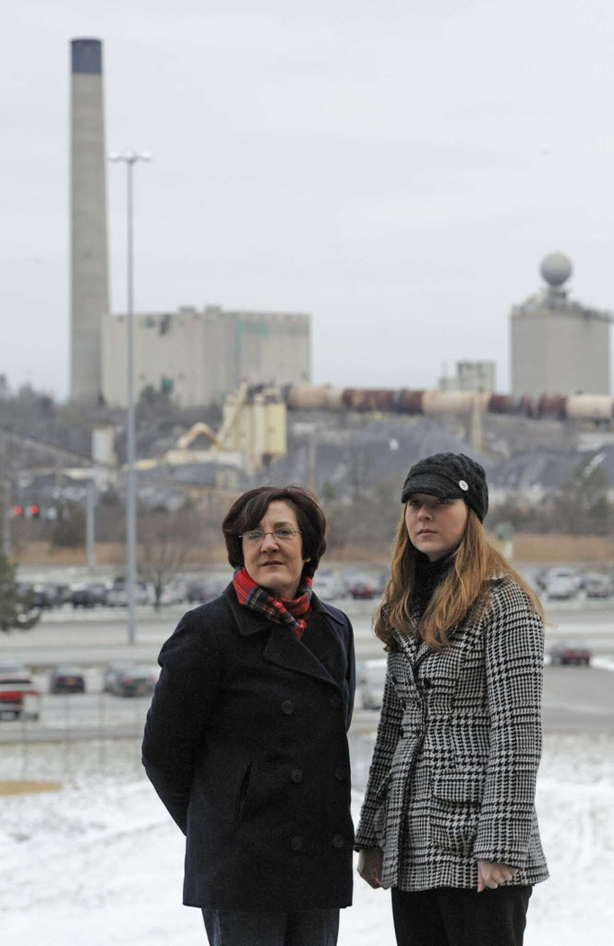 Elyse Kunz, left, and Elyse Griffin, co-founders of the Community Advocates for Safe Emissions, a grassroots organization that for the past two years has fought to make the LaFarge Cement Plant -- seen in the background in Ravena -- cleaner and more transparent. (Skip Dickstein / Times Union)