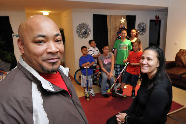 Two-time Iraq veteran Greg Easley with wife Betty and six children in their apartment, provided by Operation Homefront of Texas when they were on the verge of homelessness. Photo: Robin Jerstad/Special To The Express-News / Copyright 2010 by Robin Jerstad, Jerstad Photographics LLC, All Rights Reserved. www.JerstadPhoto.com