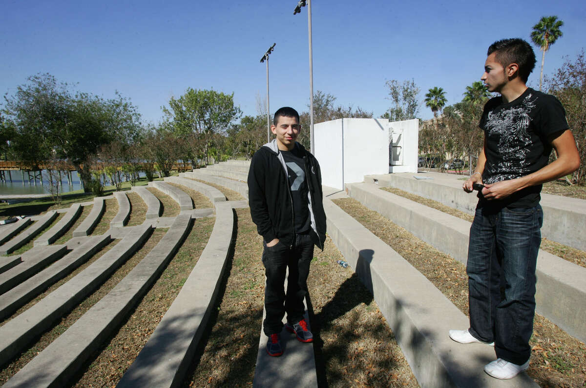 UT-Brownsville students Hector Liceaga, 19 (left), and Raul Gonzalez, 18, talk about the way the violence across bordering Mexico has affected their campus.