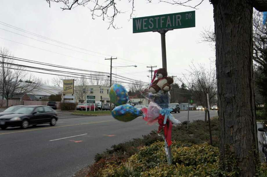 A memorial on Westfair Drive pays tribute to the late Sharon Broecking, who died Dec. 21 after being hit by a car as she crossed near the intersection of that street and Post Road East. Photo: Paul Schott / Westport News
