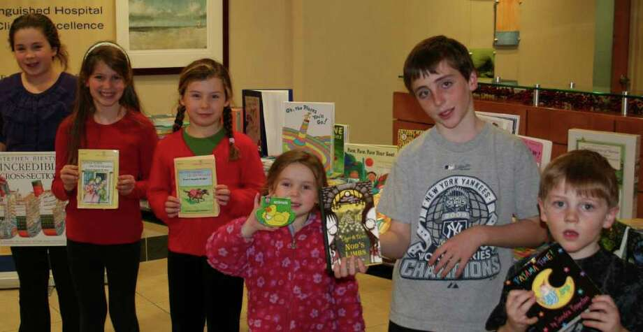 Long Lots Elementary School students deliver books to Norwalk Hospital's Pediatrics Department as part of the Children Helping Children program. From left are: Georgina Morrison, Summer Hutchison, Sophie Morrison, Darcey Morrison, and Thomas and Michael Nealon. Photo: Contributed Photo / Westport News