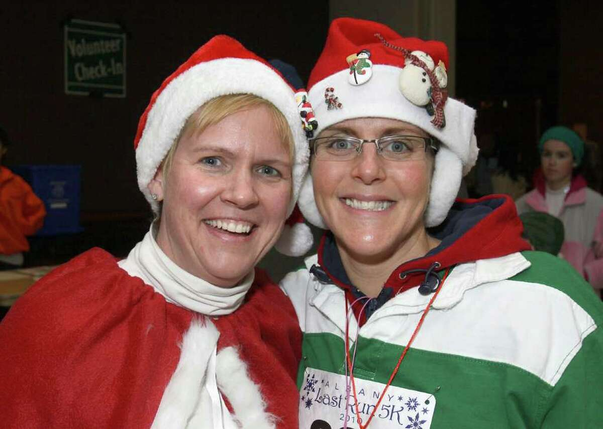 Stacey Whiteley, left, and Paula DiBiase get in a festive mood before hitting the cold to run. (Joe Putrock / Special to the Times Union)