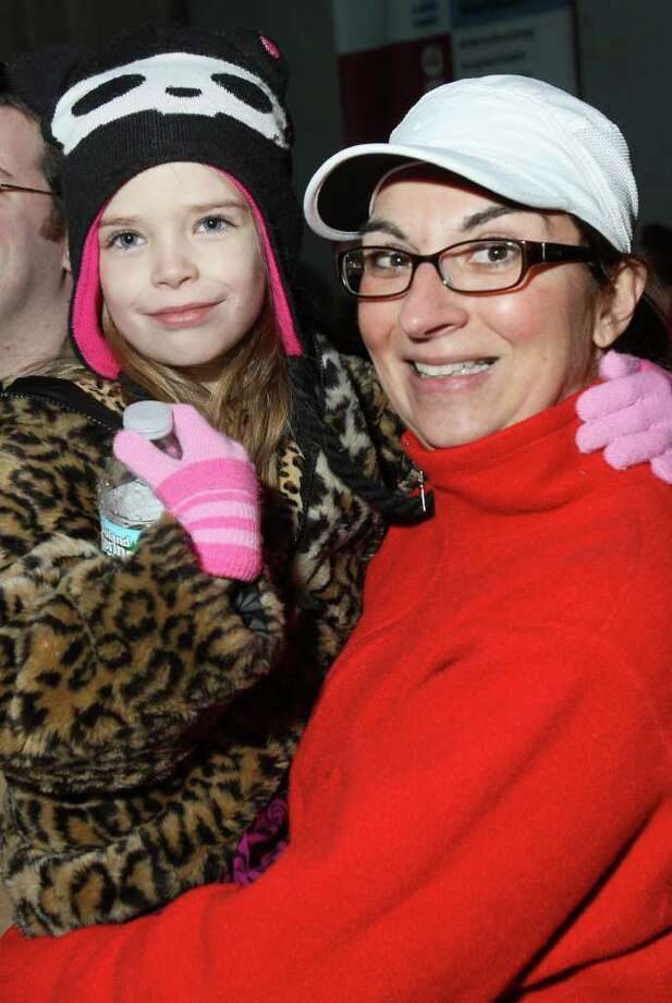 Ann Howe and her niece, Zoe Turner-Gold, watch the fireworks before the kickoff of Albany?s Last Run 5K. (Joe Putrock / Special to the Times Union) Photo: Joe Putrock / Joe Putrock