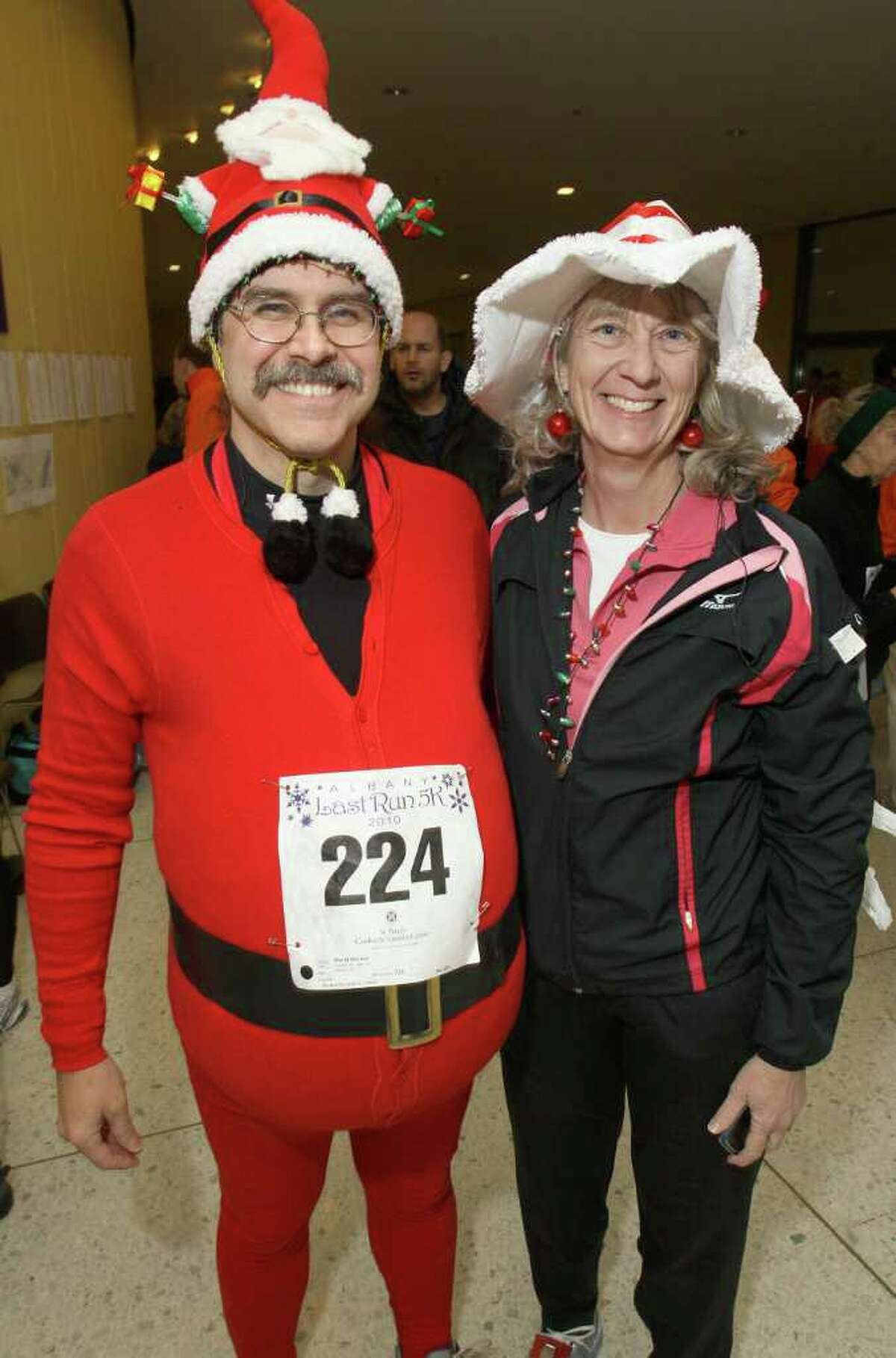 Dave and Jean Drexler get into the holiday spirit with creative running gear. (Joe Putrock / Special to the Times Union)