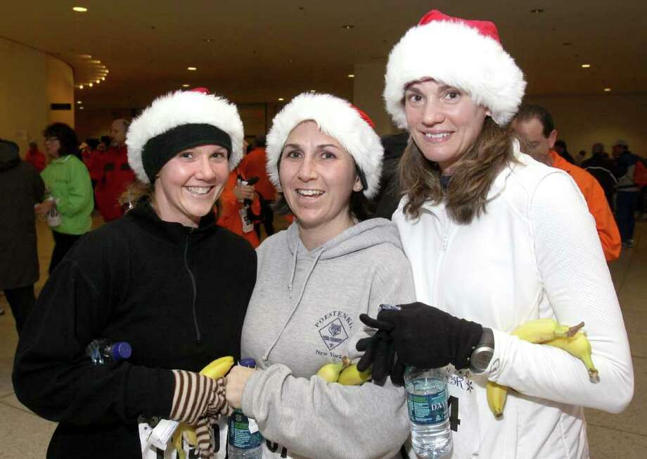From left: Elizabeth Jamison, Kelly Buttaci and Renise Holohan celebrate after running in Albany?s Last Run 5K. (Joe Putrock / Special to the Times Union) Photo: Joe Putrock / Joe Putrock