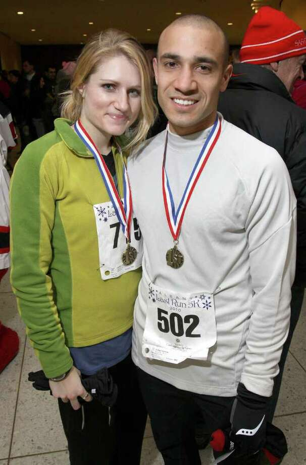 Jacquelyn Pierce and Josh Lipinski pose after being presented with medals for winning first place in their respective gender and age groups after Albany?s Last Run 5K.  (Joe Putrock / Special to the Times Union) Photo: Joe Putrock / Joe Putrock