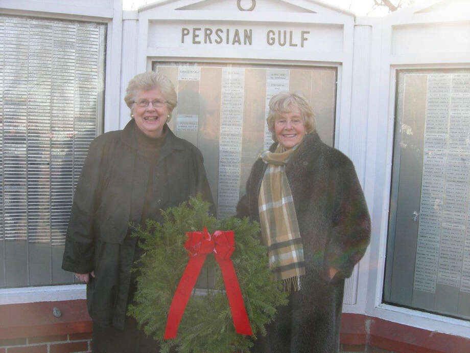 Naomi Sharpe, veteran chairman, and Pamela Huth Regent, Eunice Dennie Burr Chapter of the NSDAR, placed a wreath at placing a wreath before the Veteran's Memorial on the Old Post Road during the national Moment of Remembrance on Saturday, Dec. 11, 2010. Photo: Contributed Photo / Fairfield Citizen contributed