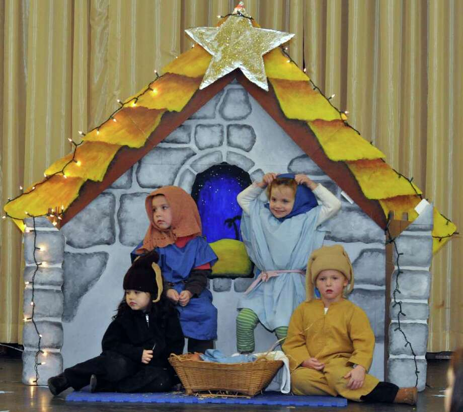 Oliver Howard, as Joseph; Lula Rosado, as the cow; Lauren vonDohlen, as Mary and Sofia Spencer, as the donkey, perform during Christ and Holy Trinity Preschool's annual Nativity Pageant at the school on Friday, Dec. 10, 2010. Photo: Amy Mortensen / Connecticut Post Freelance