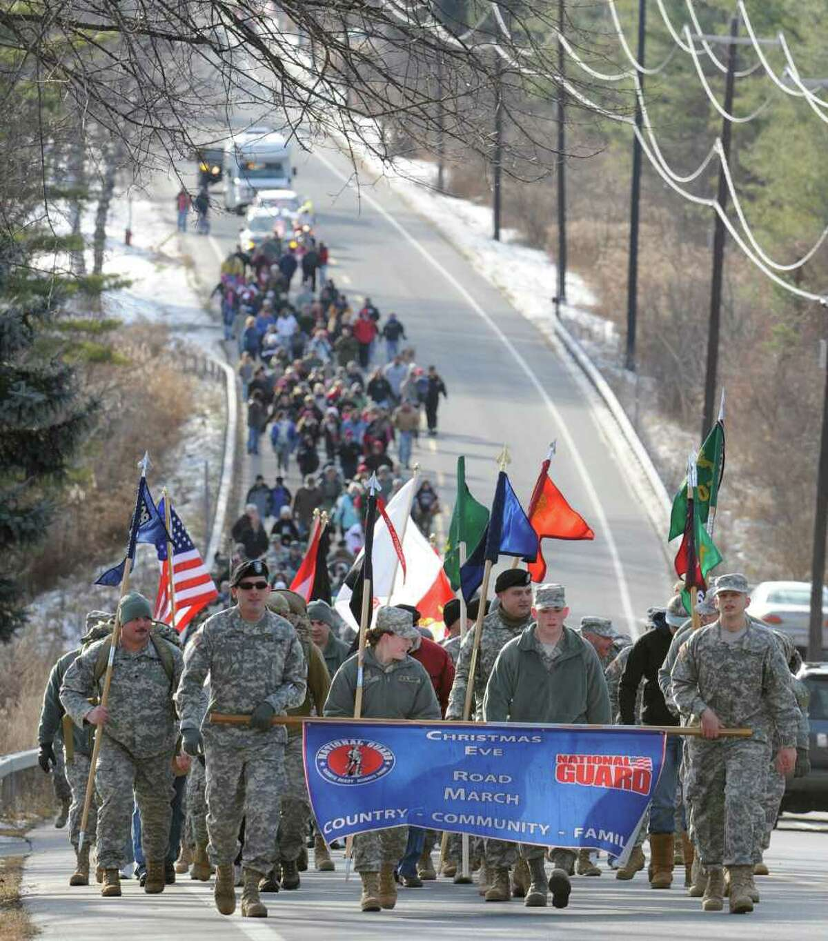 Hundreds of marchers leave the National Guard Armory in Queensbury for the annual march to support the men and women who are away from their families during holidays on December 24, 2010. (Skip Dickstein / Times Union)