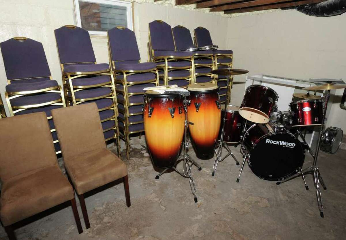 Chairs and drums are stored in the pastor's basement following a fire in the building that housed Iglesia Pentecostal Puerta de Benedicion (Pentecostal Church Door of Blessings) in Schenectady. (Lori Van Buren / Times Union)