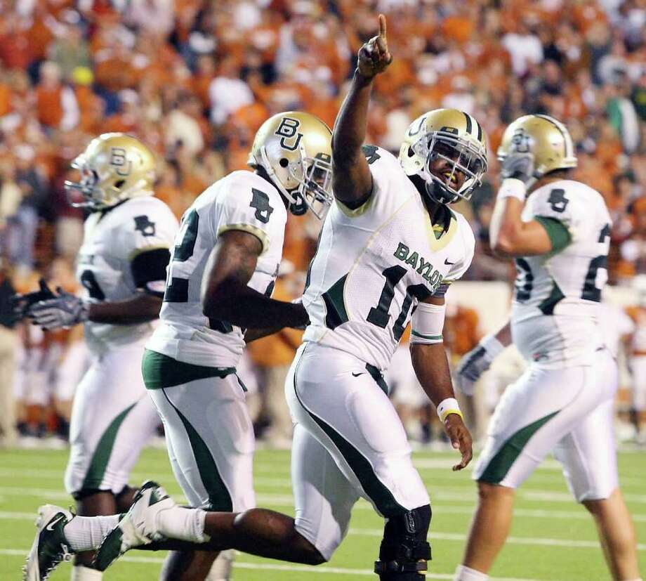 Baylor quarterback Robert Griffin sees the Bears' Texas Bowl berth as a step in the right direction, but has grander dreams for the program. Photo: Associated Press/Jerry Larson Waco Tribune-Herald