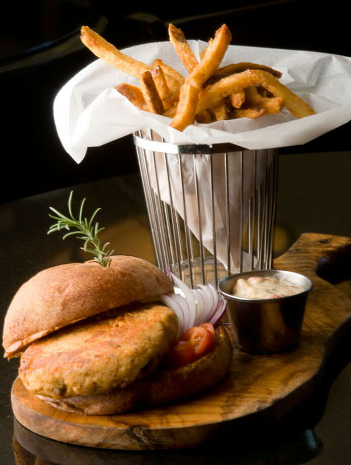 Salmon burger with frites at Brasserie Pavil.PHOTO BY ROBIN JERSTAD/SPECIAL TO THE EXPRESS-NEWS