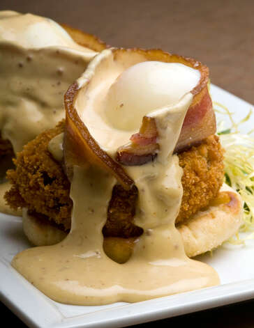 Fried green tomato eggs Benedict from the Monterey  PHOTO BY ROBIN JERSTAD/SPECIAL TO THE EXPRESS-NEWS