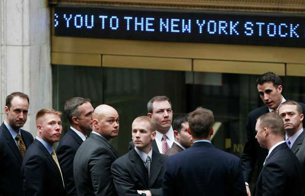 A reader likened this photo - published Dec. 18 in the Express-News Business section, but portraying 11 Wall Street executives on March 9, 2009, when the Dow Jones Industrial Average plunged to 6,547 points - to a biblical story in the Book of Genesis.