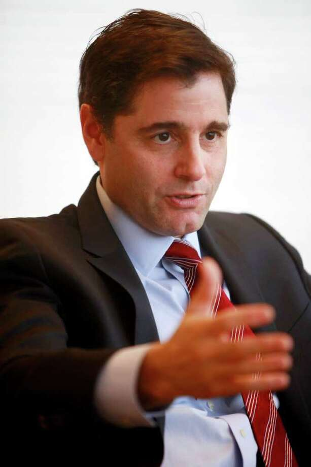 The FCC under chairman Julius Genachowski has passed, 3-2, a rule that prohibits Internet providers from blocking lawful access to their content under the label of net neutrality. Photo: Jacquelyn Martin/Associated Press