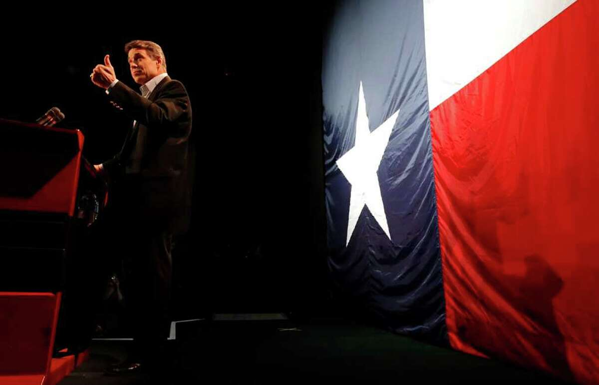2. GOP wins big: Gov. Rick Perry gave the thumbs-up to supporters at the VictoryTexas 2010 election night party.