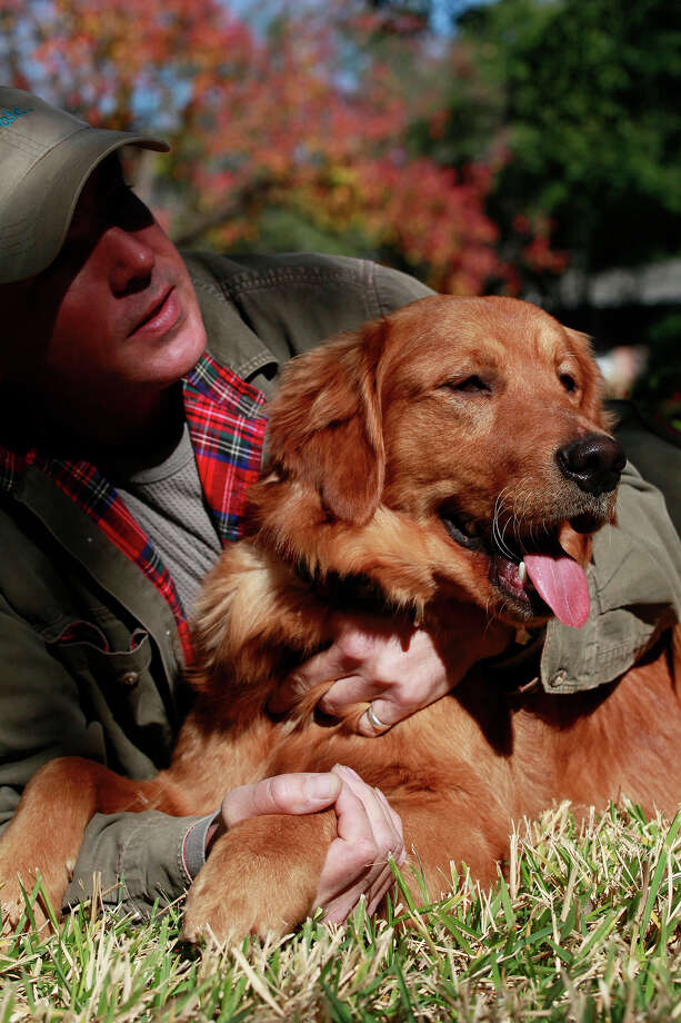 Chris Cooley and his golden retriever J.B. — short for Jim Bowie — at their home in San Antonio. Photo: LISA KRANTZ, SAN ANTONIO EXPRESS-NEWS