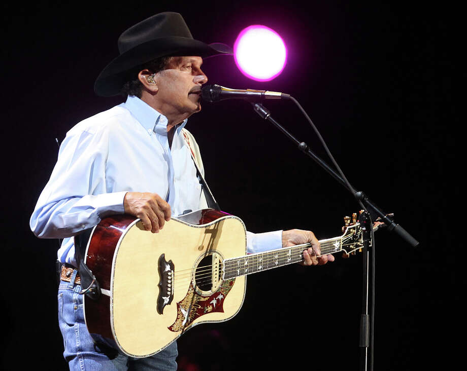 George Strait performs at the Alamodome before a crowd of about 55,000.
