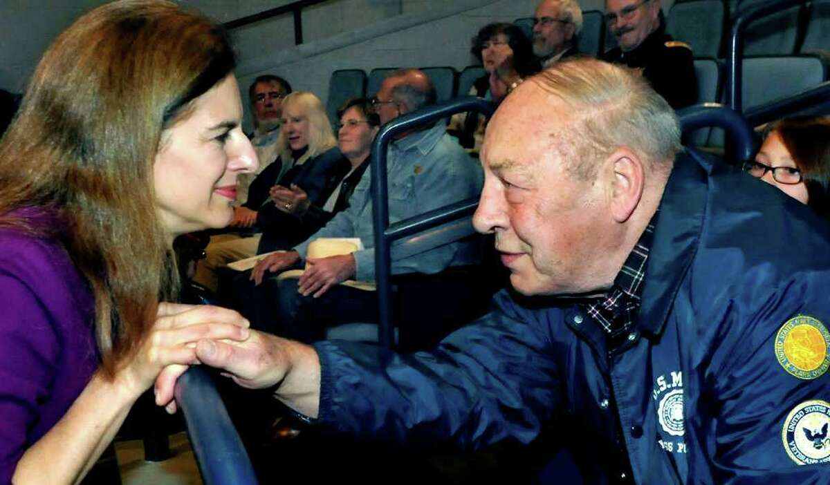 Secretary of the State Susan Bysiewicz listens to Gil Nelson share his memories of fighting in the Korean War during a public service awards ceremony at New Milford High School, Thursday, Oct. 21, 2010.