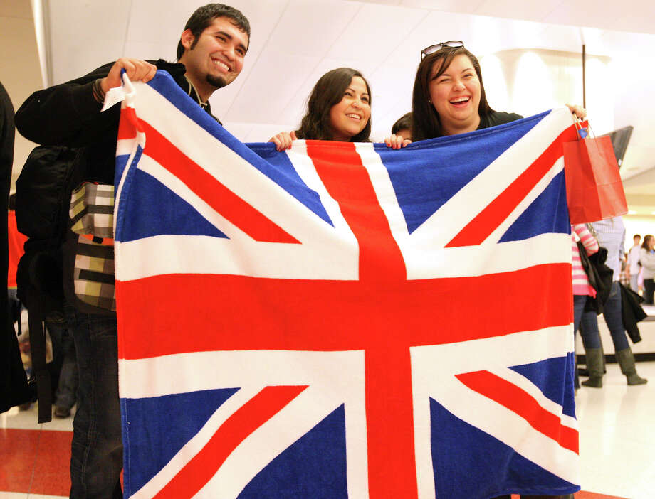 St. Mary's University students Fernando Armendariz (from left), Priscilla Ortega and Julie Forbus pose Sunday at San Antonio International Airport. They were among 19 students, along with a professor, whose return home from London was delayed a week by a blizzard there. Photo: Edward A. Ornelas/Express-News