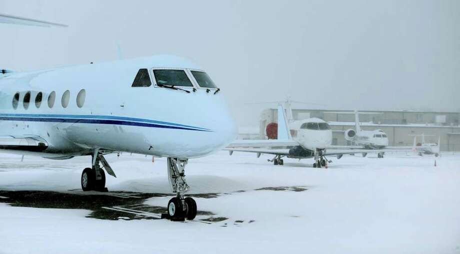 Several private jets spent Sunday night at the Million Air Flight Service at  Albany International Airport in Colonie due to the snowstorm that pummeled  the East Coast.  (Skip Dickstein / Times Union) Photo: Skip Dickstein / 2008