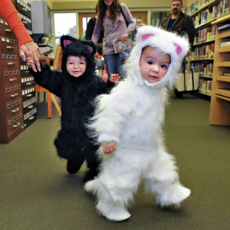 Halloween means costumes, cute kids and cute kids in costumes. These twins are doing it right. (John Carl D'Annibale / Times Union) Photo: John Carl D'Annibale / 00010807A
