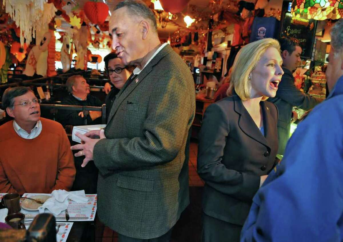 New York's U.S. senators, Charles Schumer, left, and Kirsten Gillibrand, speak with restaurant patrons at Grandma's Pies in Colonie during a campaign stop in October 2010. When the restaurant closed in August 2020, after 44 years, the owner said it was because of a sharp decline in business as the result of the coronavirus pandemic. (John Carl D'Annibale/Times Union)