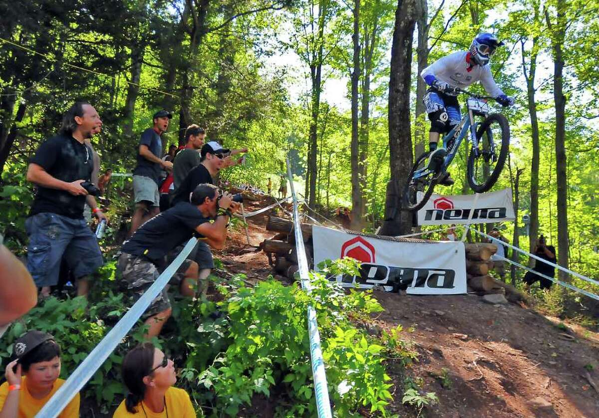 Gee Atherton makes a jump during the Windham 2010 Mountain Bike World Cup Festival Downhill Final in Windham, N.Y., Sunday August 29, 2010. Atherton ended up winning the overall World Cup for the year. (Philip Kamrass / Times Union)