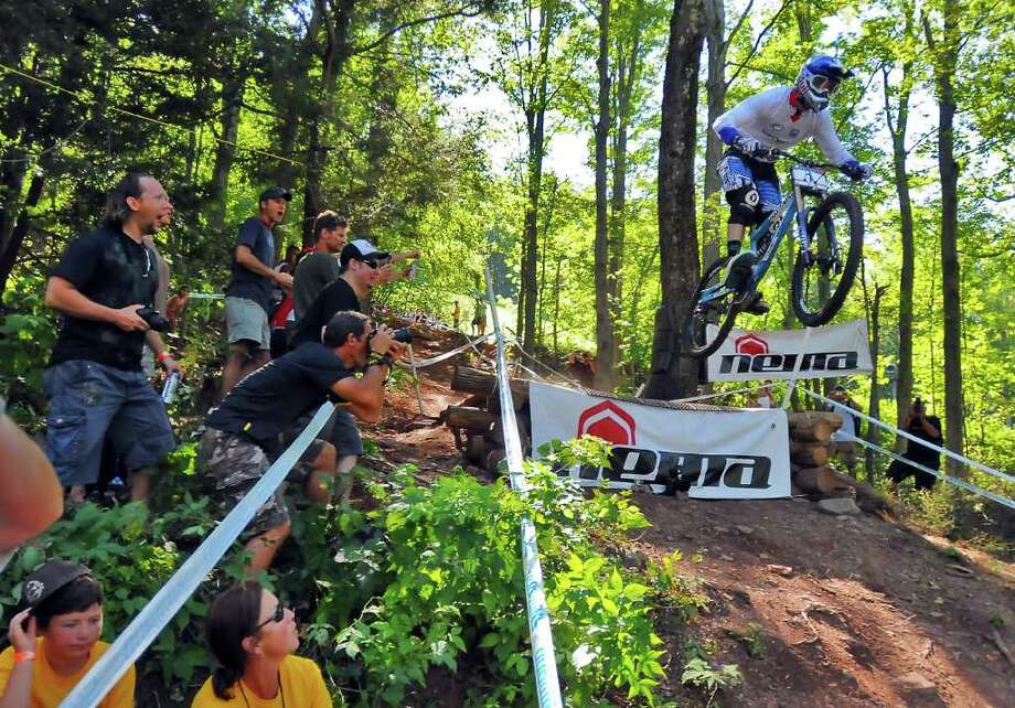 Gee Atherton makes a jump during the Windham 2010 Mountain Bike World Cup Festival Downhill Final in Windham, N.Y., Sunday August 29, 2010. Atherton ended up winning the overall World Cup for the year. (Philip Kamrass / Times Union) Photo: Philip Kamrass / 00009998A