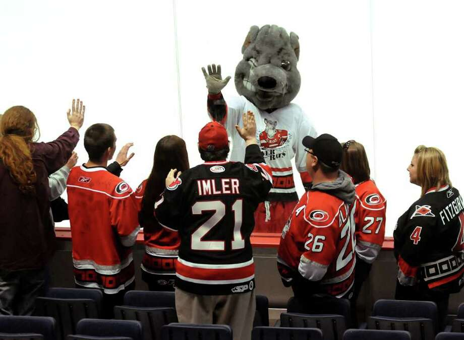 It was announced in early 2010 that the River Rats had been sold and would be moving to Charlotte. River Rats fans wave goodbye to Rowdy Rat through the plexiglass after the Rats lose 5-4 in their playoff game to the Hershey Bears on  April 29, 2010 at the Times Union Center in Albany. It was the last game for the River Rats. (Cindy Schultz / Times Union) Photo: CINDY SCHULTZ