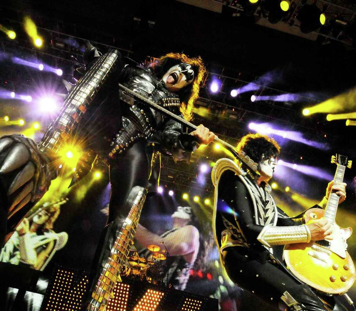 Gene Simmons sticks out his tongue in his classic fashion as Kiss performs at SPAC in Saratoga Springs on Aug. 17. (Michael P. Farrell / Times Union)