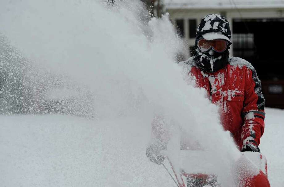Patrick Wemitt volunteers his snowblower and his time to plow out a neighbor on Kinderhook Street in Chatham after a snow storm pelted the area on Monday, Dec. 27, 2010.   (Skip Dickstein / Times Union) Photo: SKIP DICKSTEIN / 2008