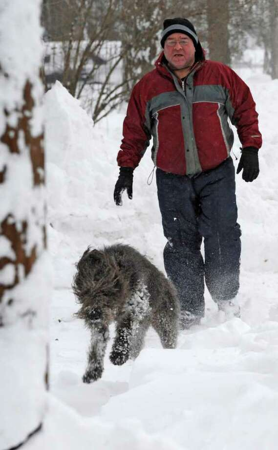 Tommy Carlucci walks down Kinderhook Streeet in Chatham following his dog, Joy, as she bounds through the drifts after a snow storm pelted the area on Monday, Dec. 27, 2010.   (Skip Dickstein / Times Union) Photo: SKIP DICKSTEIN / 2008