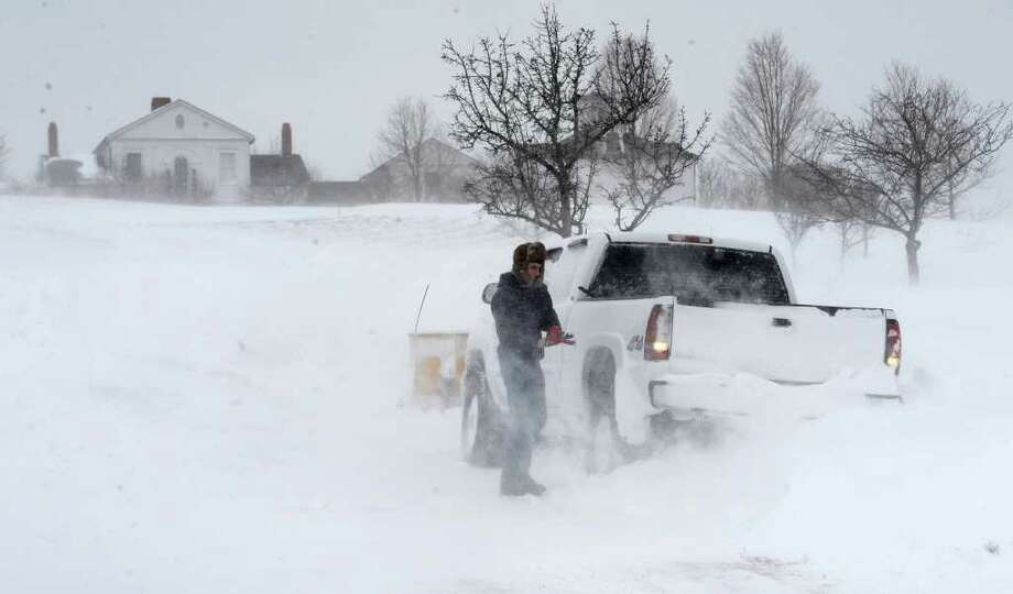 Travis Mitchison prepares to removes his snow plow from a large drift on Route 17 in North Chatham after a snow storm pelted the area on Tuesday, Dec. 27, 2010.   (Skip Dickstein / Times Union) Photo: SKIP DICKSTEIN / 2008