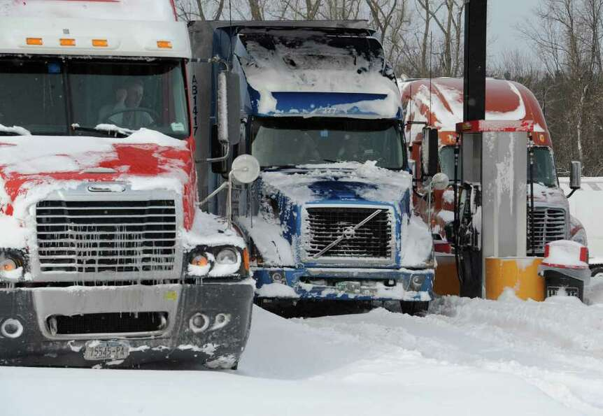 Truckers take refuge from the inclement weather and high winds at a truck stop near exit 11 on Inter