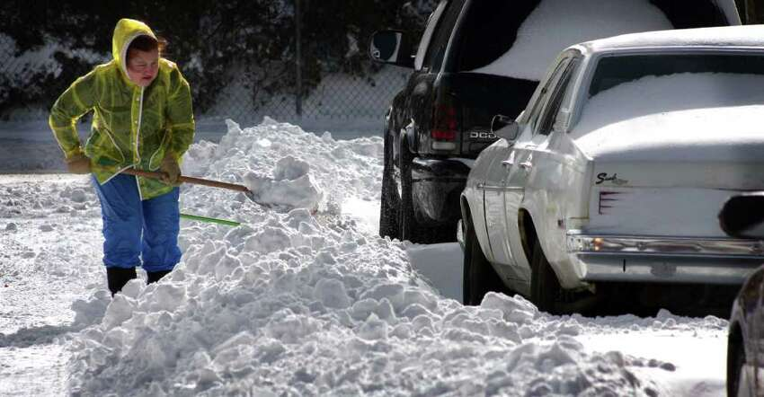 Residents begin to dig out after over a foot of snow fell Sunday night in Stratford.